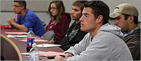 Students in a hybrid class lecture
